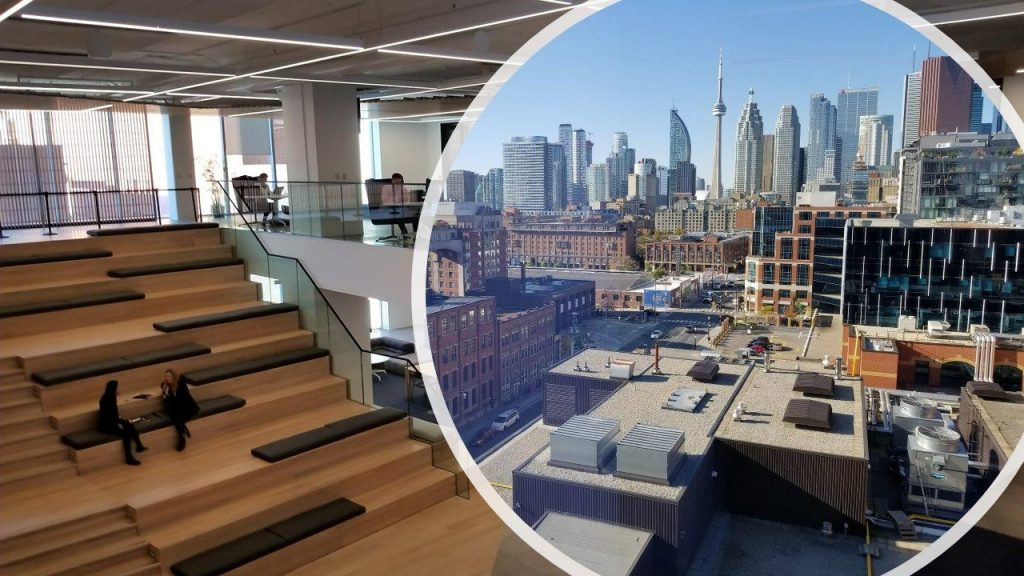 Image of an office seating area and a city view of Toronto and the CN Tower