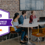 Image of a group with people talking around a table, with the text '2019 Small Business Grant Context - FedEx' written on the side