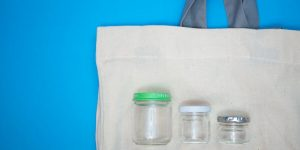 three glass jars on a white bag