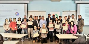 Group photo of event attendees holding certificates