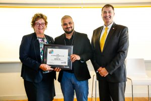 Anne Sado and Neal Lilliott presenting Madhur Tyagi with the startGBC 2019 Student Entrepreneur of the Year Award